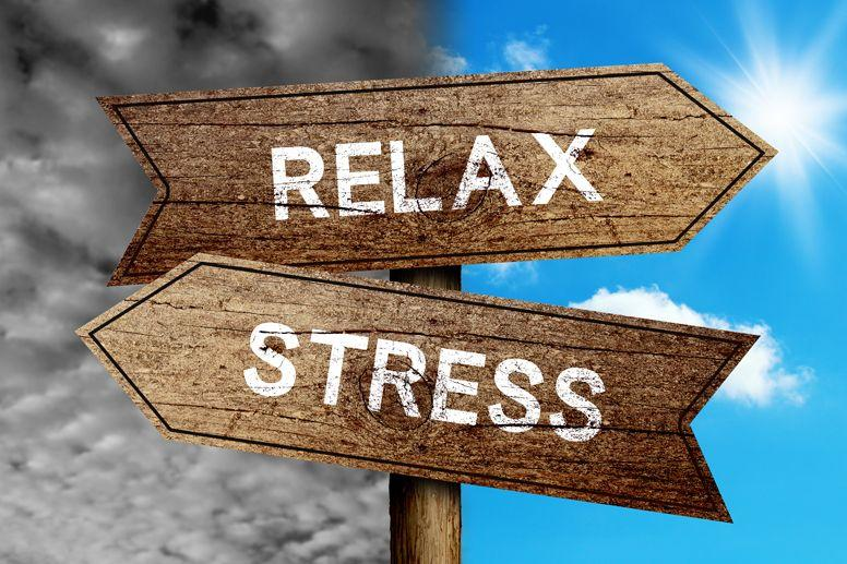 Road sign pointing to relax and stress