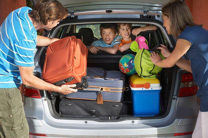 family preparing car for holiday