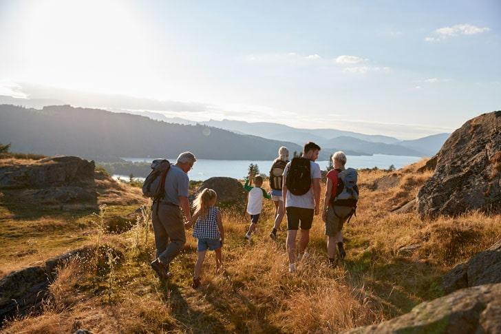 Family walking on hill in Lake District UK