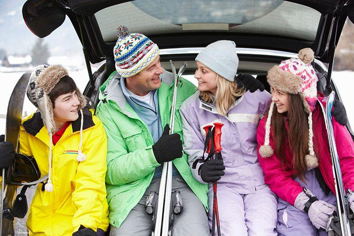 Family with rental car on ski holiday