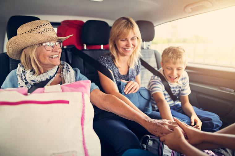 Senior woman with family on road trip