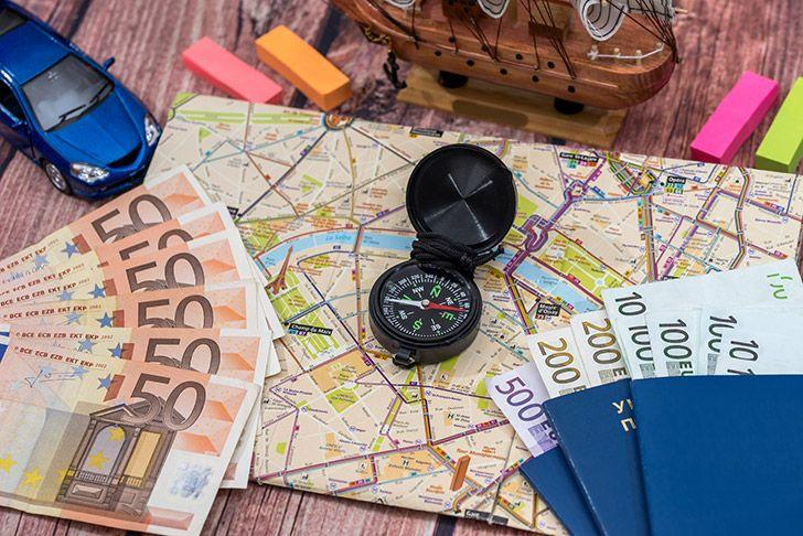 Travel map with money and compass