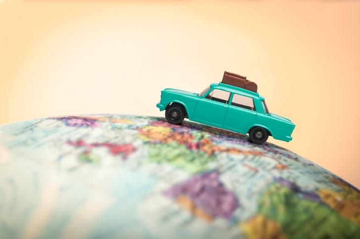 Vacationing toy car on a globe
