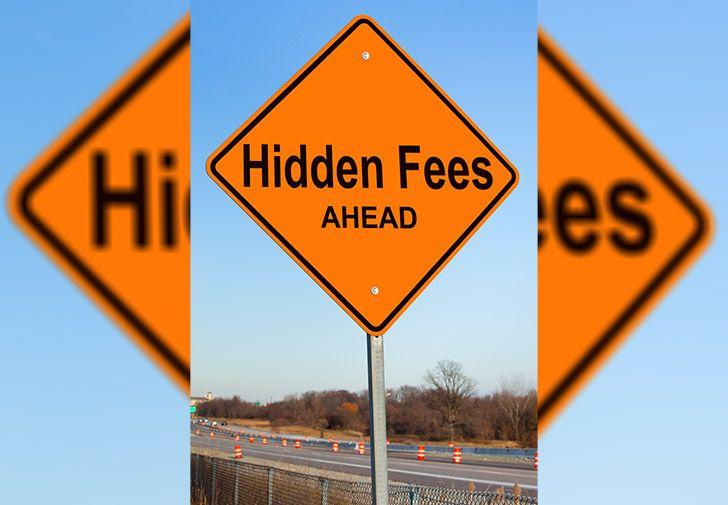 Hidden fees ahead road sign